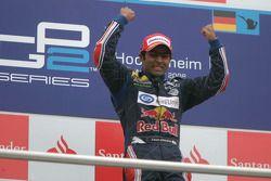 Karun Chandhok celebrates his victory on the podium