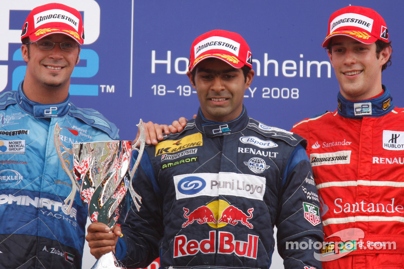 Karun Chandhok celebrates his victory on the podium with Andreas Zuber and Bruno Senna