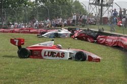 Robbie Pecorari slams into the tire barrier in corner 5 as Richard Antinucci slides through the grass