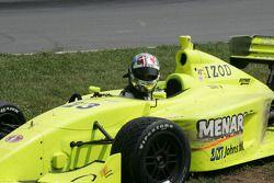 Logan Gomez climbs from his damage race car