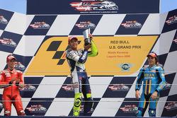 Podium: race winner Valentino Rossi, second place Casey Stoner, third place Chris Vermeulen