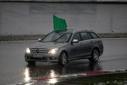 Safety car drives around with a green flag to wave off the qualifying due to weather reasons