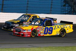 Bobby East battles for position with Todd Bodine