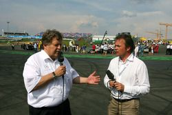 Norbert Haug, Sporting Director Mercedes-Benz, being interviewed before the start of the race