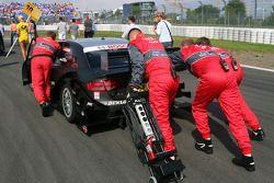Audi mechanics pushing the car of Timo Scheider, Audi Sport Team Abt, Audi A4 DTM, up hill
