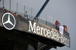 One very brave dare-devil Audi fan waves a single Audi flag on the sole Mercedes Benz grandstand!