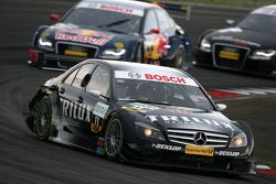 Ralf Schumacher, Mücke Motorsport AMG Mercedes, AMG Mercedes C-Klasse, leads Mattias Ekström, Audi Sport Team Abt Sportsline, Audi A4 DTM, Timo Scheider, Audi Sport Team Abt, Audi A4 DTM