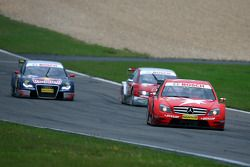 Gary Paffett, Persson Motorsport AMG Mercedes, AMG-Mercedes C-Klasse, leads Mike Rockenfeller, Audi Sport Team Rosberg, Audi A4 DTM and Mattias Ekström, Audi Sport Team Abt Sportsline, Audi A4 DTM