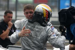 Race winner Bernd Schneider celebrates with Paul di Resta