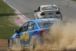 Robert Huff, Chevrolet, Chevrole Lacetti goes off and Jorg Muller, BMW Team Germany, BMW 320si takes