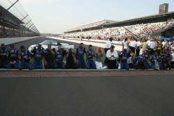 Jimmie Johnson and his team prepare to kiss the bricks