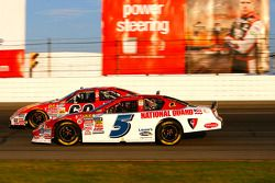 Landon Cassill passes the slowing car of Carl Edwards