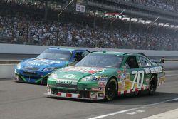 Jason Leffler and J.J. Yeley leave the pit lane