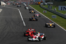 Timo Glock, Toyota F1 Team, TF108 and Kimi Raikkonen, Scuderia Ferrari, F2008