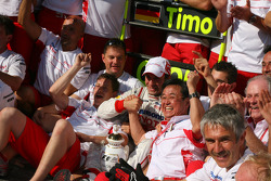 Timo Glock celebrates with Toyota F1 team
