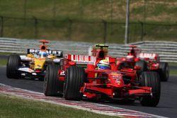Felipe Massa, Scuderia Ferrari, F2008 and Fernando Alonso, Renault F1 Team, R28