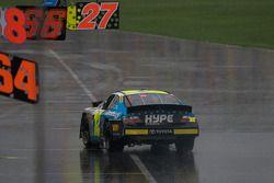 Jacques Villeneuve on pit road wth heavy damage