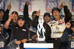 Victory lane: race winner Ron Fellows celebrates with his team