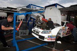 Fitz Racing crew members change motor on the car of Andrew Ranger