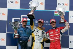 Lucas di Grassi celebrates his victory on the podium with Andreas Zuber and Bruno Senna