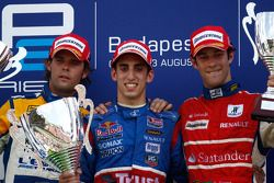 Sebastien Buemi celebrates his victory on the podium with Andy Soucek and Bruno Senna