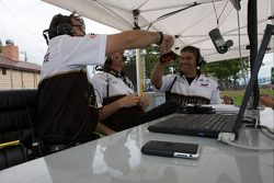 AIM Autosport crew members celebrate pole position