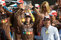 Victory lane: race winner Kyle Busch accepts the winner's cup