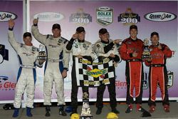Podium: race winners Brian Frisselle and Mark Wilkins, second place Jon Fogarty and Alex Gurney, thi