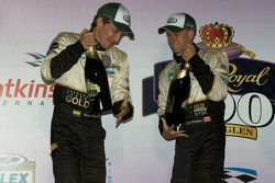 Podium: race winners Brian Frisselle and Mark Wilkins celebrate with champagne