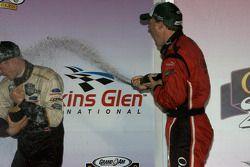 Podium: Alex Gurney sprays champagne