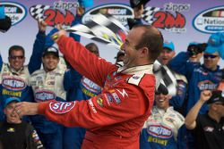 Victory lane: race winner Marcos Ambrose celebrates