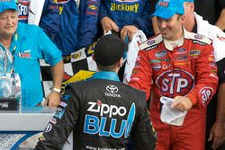 Victory lane: race winner Marcos Ambrose celebrates with Kyle Busch