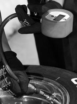 Newman Wachs Racing crew member takes tire pressure
