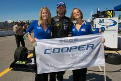 Pole winner Jonathan Bomarito celebrates with the charming Cooper Tires girls