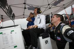 Kevin Buckler and Andy Lally watch qualifying