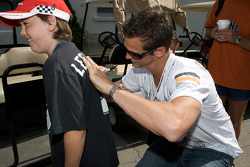 Tampa Bay Lightning hockey club superstar Vincent Lecavalier signs the t-shirt of a young fan