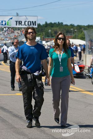 Pole winner Jonathan Bomarito and his lovely wife walk to the starting grid