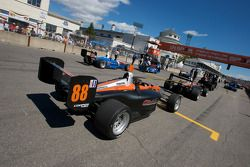 Brooks Associates Racing car of Tom Sutherland is taken to the starting grid