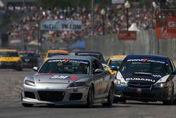#49 Brass Mitchell Racing Mazda RX-8: Tony Rivera, Stuart Robinson and #111 ICY/ Phoenix Racing Subaru Legacy: Chuck Hemmingson, Kristian Skavnes