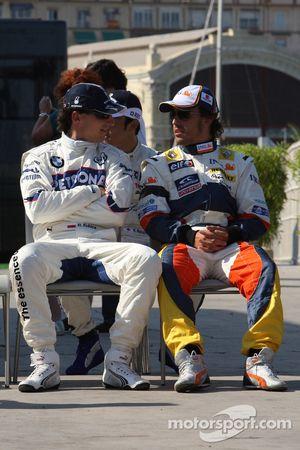 Robert Kubica, BMW Sauber F1 Team and Fernando Alonso, Renault F1 Team