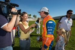 Race winner Andrew Ranger gives TV interviews