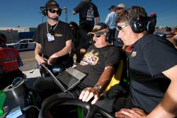 Crew of J.R. Fitzpatrick and Don Thomson Jr. watch the end of qualifying as both drivers battle for the pole