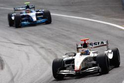Vitaly Petrov leads Pastor Maldonado