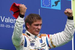 Vitaly Petrov celebrates his victory on the podium