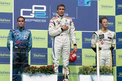 Vitaly Petrov celebrates his victory on the podium with Pastor Maldonado and Romain Grosjean