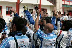 The Barwa International Campos Team celebrate Vitaly Petrov victory
