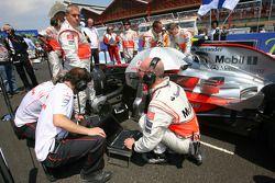 McLaren Mechanics with a computer