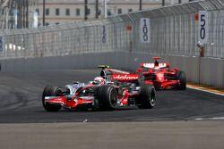 Heikki Kovalainen, McLaren Mercedes leads Kimi Raikkonen, Scuderia Ferrari