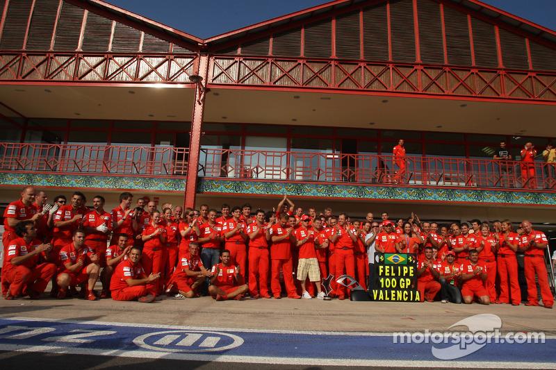 Race winner Felipe Massa celebrates with Kimi Raikkonen and Scuderia Ferrari team members