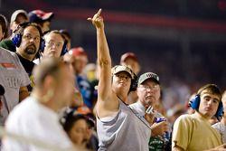 A fan shows her emotion as Kyle Busch regains the lead